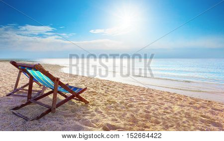 couples of wood chair beach and blue sky at sea side for summer vacation