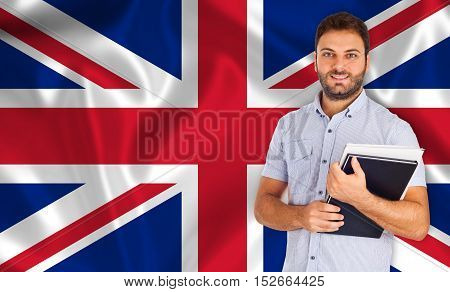 Student smiling over English flag. Concept of lessons and learning of foreign languages.