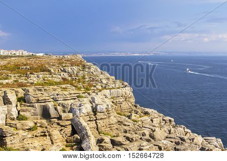background landscape view of the rocks and the Atlantic Ocean to the Peniche peninsula, near the island of Berlenga, Portugal