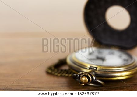 Pocket Watch Against A Rustic Background