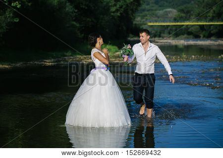 Couple Kissing In River Water