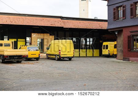 Yellow van yellow truck and pick-up in industrial environment near factory and distribution warehouse