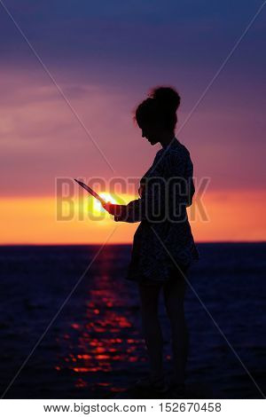 Female Silhouette With Laptop On Sunset