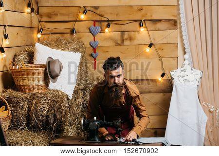 Tailor Man Sews Clothes