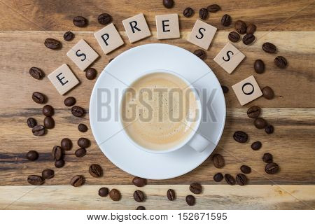 Espresso with coffee beans letter concept picture