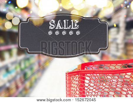 cart in supermarket store with sale text on black lable