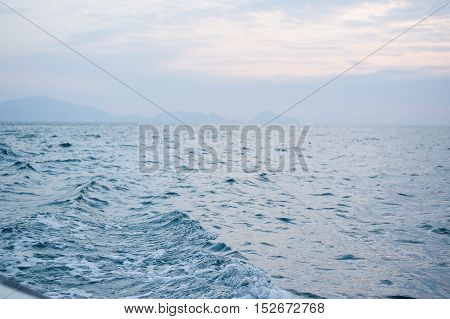 Sea wave on the sea at sunset time background