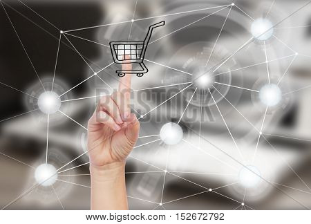 Mobile shopping concept - someones hand pointing on cart