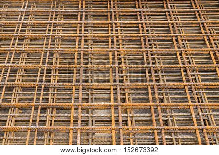 Close up of rusty iron bars on a construction site