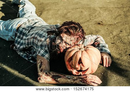 Zombie Man Lies On Pumkin