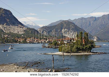 View on of the one of Borromean Islands - Scoglio della Malghera - behind him Isola dei Pescatori and landscape of Lago Maggiore