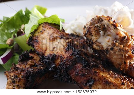 Grilled chicken with potato salad and green salad.