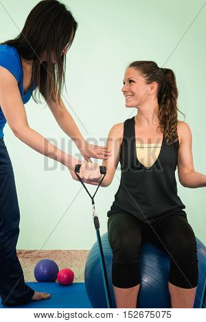 Physical therapy exercising with resistance band, toned image