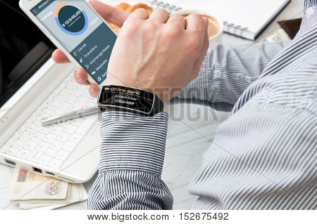 Businessman receives access code to bank mobile application on his smartwatch