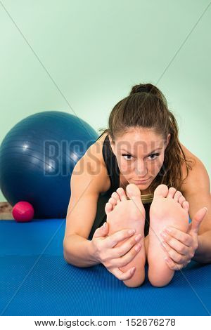 Flexibility exercise - young woman stretching, toned image