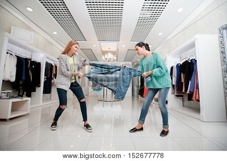 Women fighting for a jacket