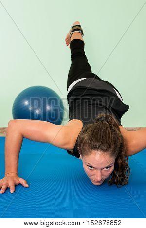 Female athlete exercising, toned image, vertical image