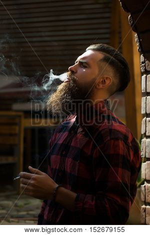 Adult Man Exhaling Cigarette Smoke