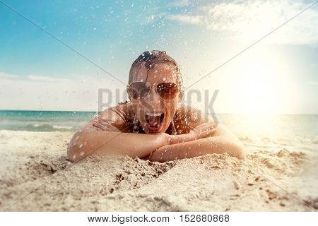 girl enjoying water splash on the beach