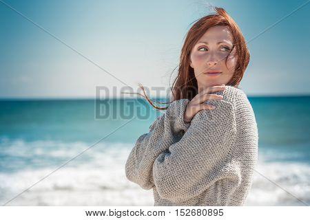 female walking down the coastline