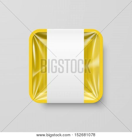 Empty Yellow Plastic Food Square Container with Label on Gray Background