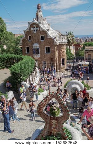 Barcelona, Spain - 24 September 2016: Park Guell entrance Dragon Fountain. Visitors at The Dragon Fountain after the park entrance.