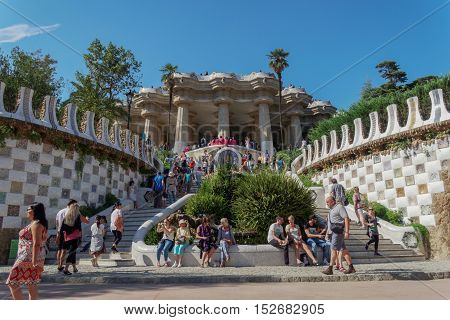 Barcelona, Spain - 24 September 2016: Park Guell stairway to the Hypostyle Room. The Dragon Fountain leading to the central terrace Nature Suare Placa de la Natura.