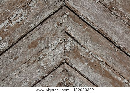 Obsolete old peeled off wooden planks background