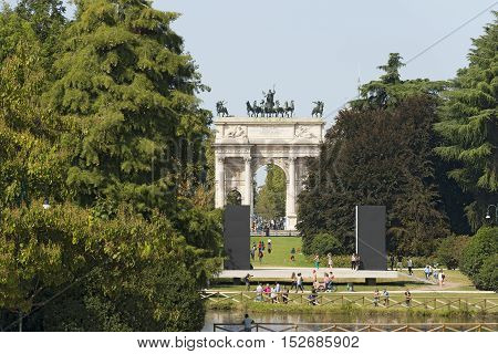 MILAN LOMBARDY ITALY - SEPTEMBER 24 2016: Arco della Pace (Arch of Peace 1814) in the Parco Sempione (Sempione park) is a large city park in downtown of Milan Italy