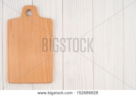 Kitchen board on an old white wooden table. Top view.