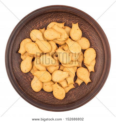 Goldfish Crackers in brown plate. Isolated on white background. Top view.