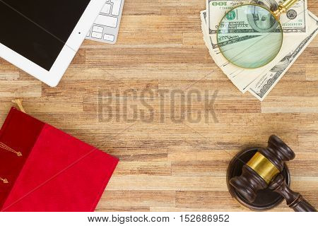 Wooden Law Gavel with legal book, dollars and pc keyboard