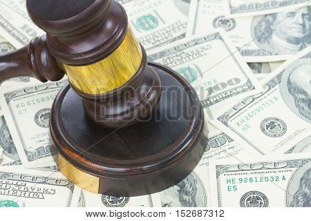 Wooden Law Gavel and Dollars Money close up