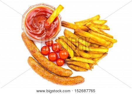 Homemade fast food portion of french fries ketchup grilled sausages and cherry tomato isolated on white background top view
