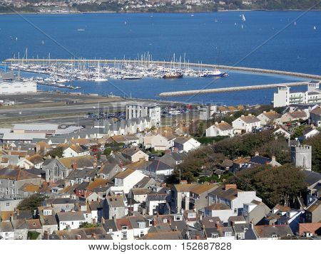 View from Portland over the village of Chesil and marina Dorset England UK