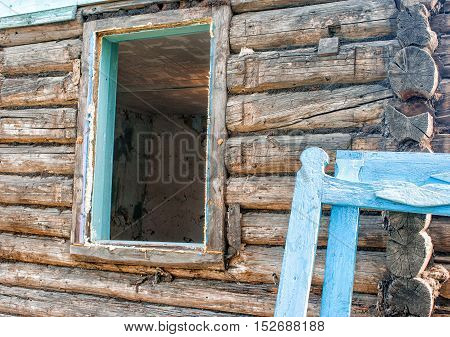 repair of wooden house on sunny summer day
