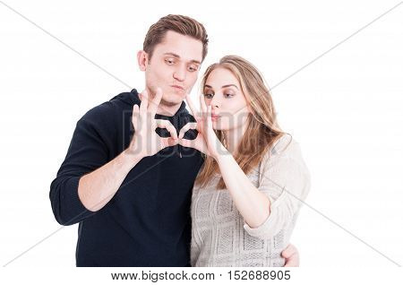 Couple Posing Playful And Showing Ok Gesture
