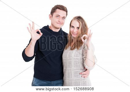 Attractive Couple Posing And Showing Ok Gesture