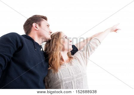 Low Angle Of Couple Pointing And Wearing Autumn Clothes