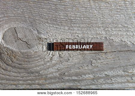 Wooden Cube With The Name Of The Month At The Old Board. February