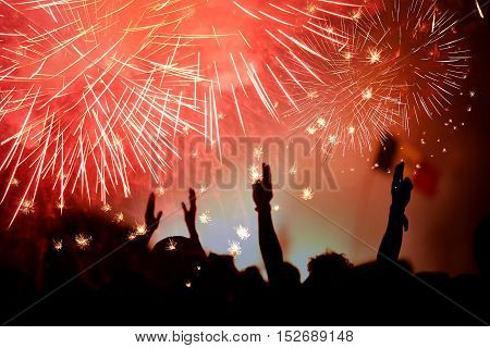 Crowd Celebrating The New Year With Fireworks