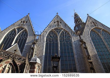 Old church in Amsterdam, Netherlands. The 800 year old Oude Kerk (Old Church) is Amsterdam oldest building and oldest parish church.