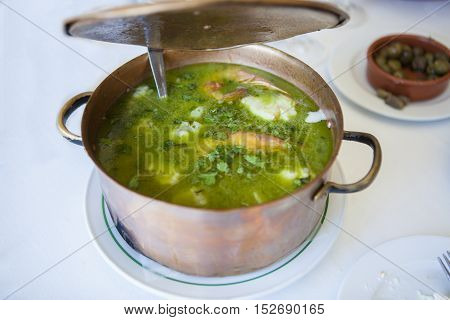 Arroz de Tamboril or soupy seafood rice portuguese recipe. Opening casserole lid
