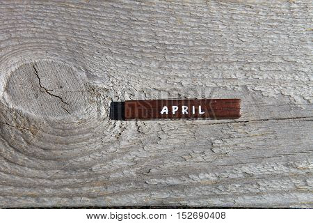 Wooden Cube With The Name Of The Month At The Old Board. April