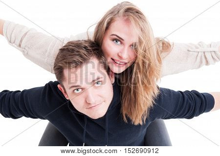 Close-up Of Handsome Couple Being Playful Posing As Airplanes