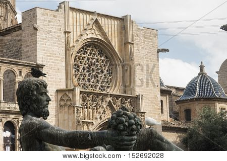 VALENCIA, SPAIN - JULY 14, 2016: Valencia (Spain) historic fountain in plaza de la Virgen representing the Turia river and the gothic cathedral