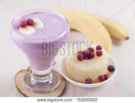 Smoothies of banana canned pineapple and frozen cranberry with yogurt.