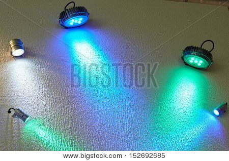 Large And Small Colored Led Spotlight On The Wall.