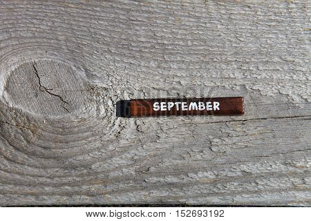 Wooden Cube With The Name Of The Month At The Old Board. September