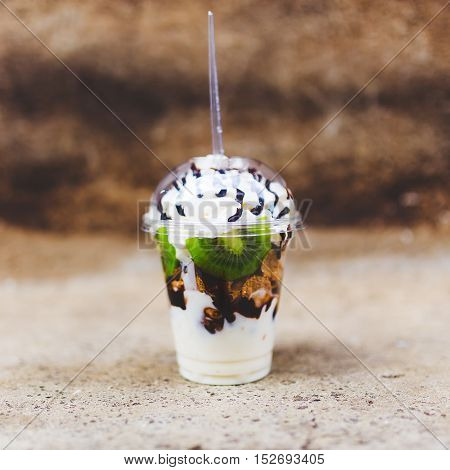 Square Food Background, Whipped Cream Kiwi Dessert In Plastic Cup.
